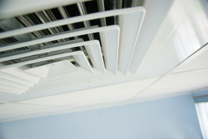 air condition vent in office ceiling close up.
