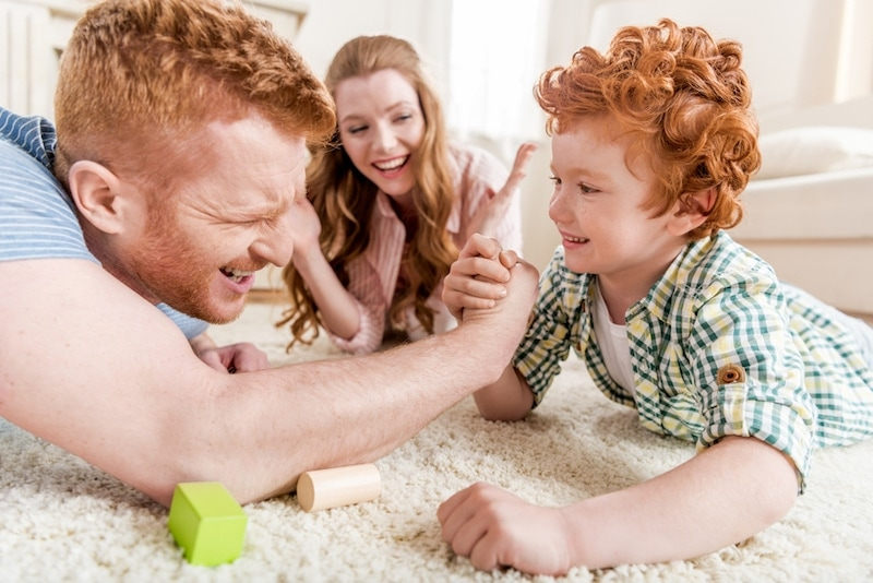 Family arm wresting over air conditioning unit vs. heat pump.