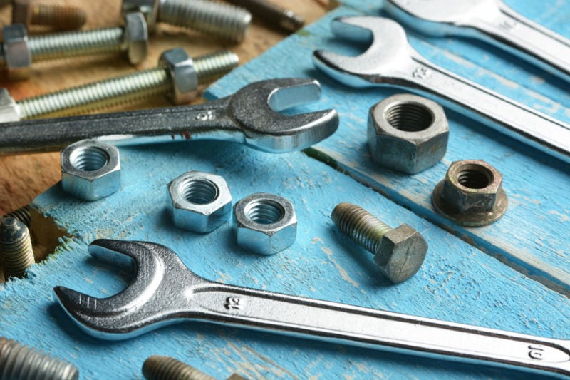 Bolts and Wrenches on a Table