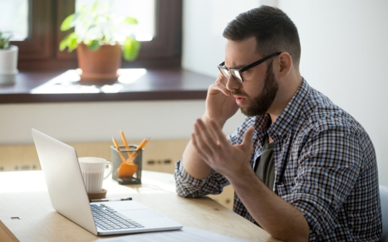 Man sitting at his computer